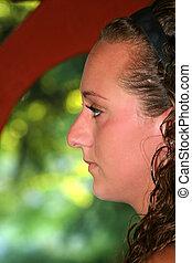 Serious Teen Girl In Profile