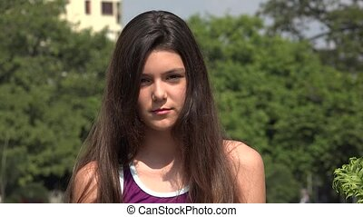 Serious Teen Girl With Long Hair