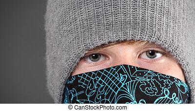 Serious Teenage  Boy wearing hat and bandana
