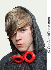 Serious Teenage  Boy wearing headphones
