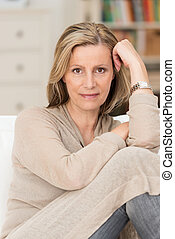 Serious thoughtful middle-aged woman