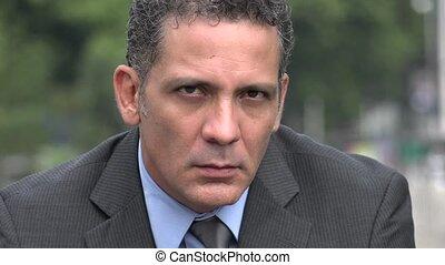 Serious Unemotional Adult Hispanic Businessman