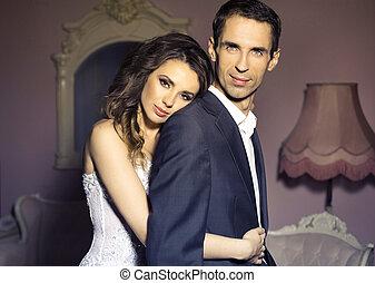 Serious wedding couple in romantic pose - Serious wedding ...