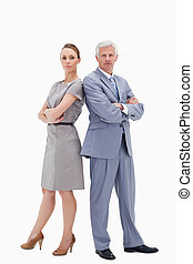 Serious white hair businessman back to back with a woman