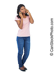 Serious woman calling with her mobi