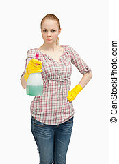 Serious woman holding a spray bottl