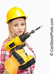 Serious woman holding an electric screwdriver