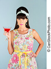 Serious woman in dress holding alcoholic beverage
