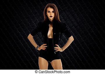 serious woman in jacket and high panties posing on camera...