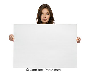 Serious woman keeping copyspace - Half-length portrait of ...
