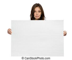 Serious woman keeping copyspace - Half-length portrait of...