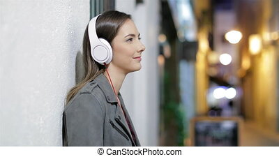 Serious woman listening to music in the night - Serious...