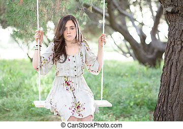 Serious Woman on a Swing