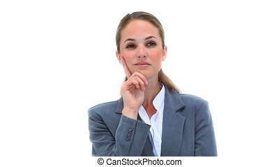 Serious woman placing her finger on her cheek