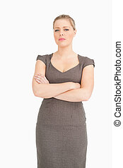Serious woman standing with arms crossed
