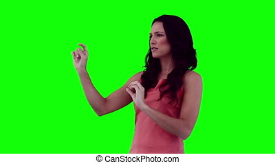 Serious woman using a virtual touchscreen