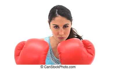 Serious woman using boxing gloves