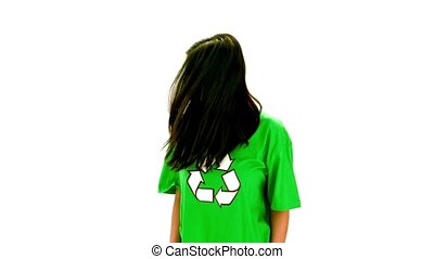 Serious woman wearing green shirt with recycling symbol on...