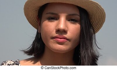 Serious Woman Wearing Hat