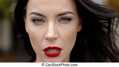 Serious woman with vivid makeup - Attractive woman with...