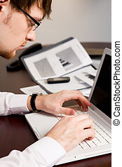 Serious work - Photo of serious boss typing on laptop his...