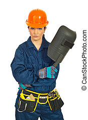 Serious worker woman with welding mask