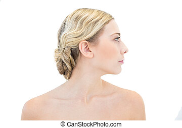 Serious young blonde woman looking away