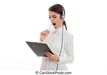 serious young business woman working in call center with headphones and microphone make notes isolated on white background