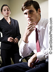 Serious young businessman with colleague