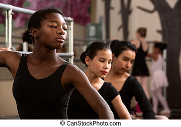 Serious Young Dancers - Three young ballet dancers in a...