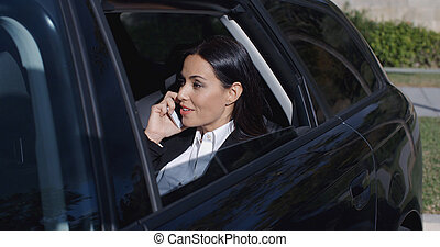 Serious young executive on phone in limousine - Serious...