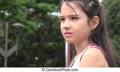 Serious Young Girl Looking at Distance