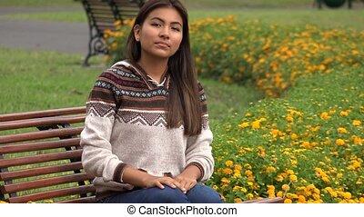 Serious Young Hispanic Female Teen