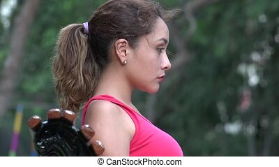 Serious Young Hispanic Woman With Ponytail