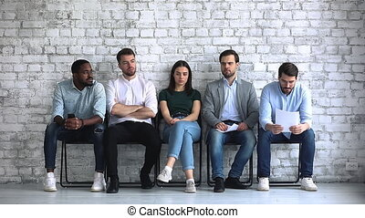 Serious young mixed race job applicants feeling nervous ...