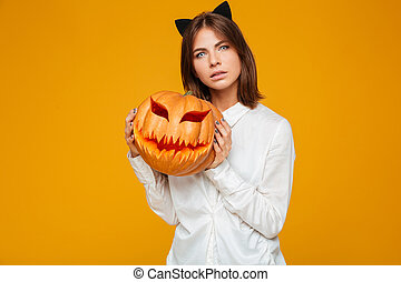 Serious young woman dressed in crazy cat halloween costume