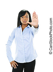 Serious young woman giving stop gesture - Serious black...