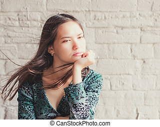serious young woman looking away