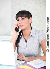 Serious young woman on the telephone