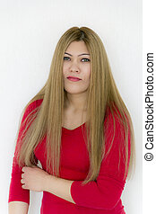 Seriously girl with long brown healthy straight hair in red