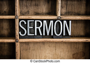 """The word """"SERMON"""" written in vintage metal letterpress type in a wooden drawer with dividers."""
