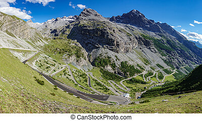 Serpentine road and mountain peaks in Stelvio Pass from ...
