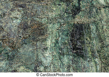 Serpentine is a lot like greenstone but it hasn't suffered as much heat and pressure.