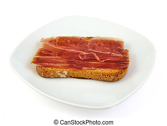 Serrano ham on toasted bread. Jabugo. Spanish tapa.