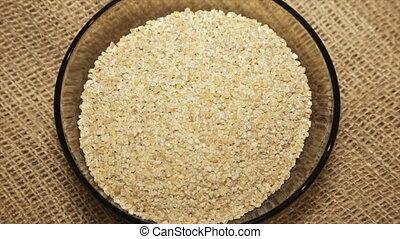 Serve barley cereals in rotation, close-up.slow motion