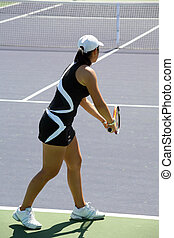 Serve - Woman serving the ball at the professional tennis...