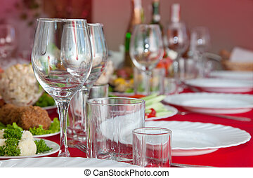 Served a banquet table with wine glasses, glasses and plates