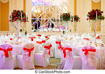 Served banquet table with flowers and candles