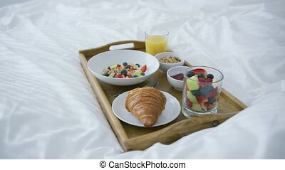 Served breakfast on bed - Composed delicious fruit mix in...