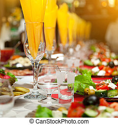 Served for a banquet table. Wine glasses with napkins, ...